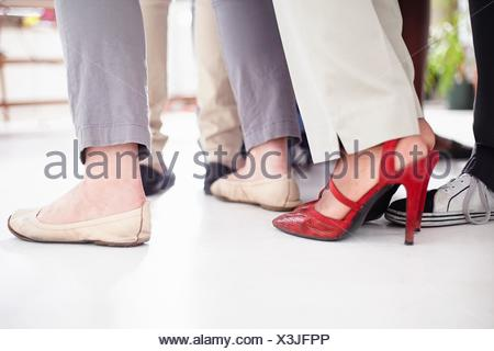 Cropped view   colleagues feet in huddle - Stock Photo