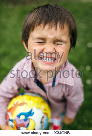Angry little boy with closed eyes - Stock Photo