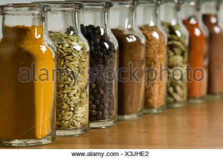 Row of spice jars - Stock Photo