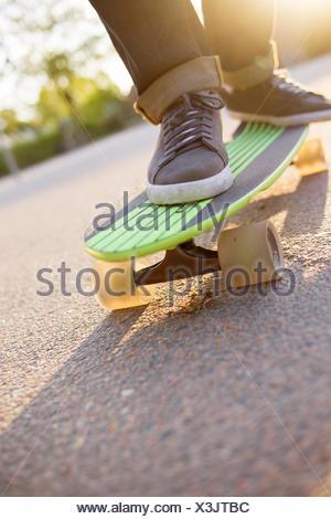 Sweden, Feet of man on skateboard - Stock Photo