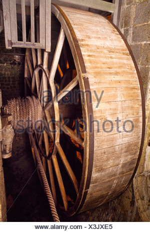 Abbey Tread wheel used to haul supplies up at the Mont Saint-Michel, Manche department, Lower Normandy, France. - Stock Photo