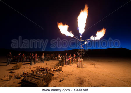 A homemade flame effects shoots propane fireballs into the night sky at the High Sierra Fly In event int eh Nevada Desert - Stock Photo