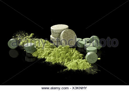 Green dietary supplements. - Stock Photo