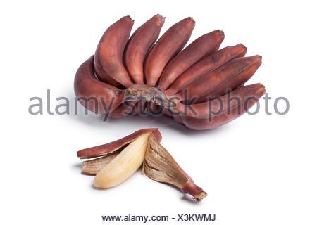 Bunch of fresh ripe red bananas on white background. - Stock Photo
