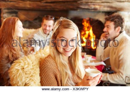 Woman enjoying drinks with friends - Stock Photo