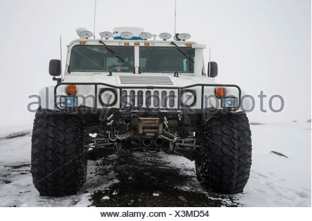 Hummer converted to a Super Jeep in a winter landscape, Iceland, Europe - Stock Photo