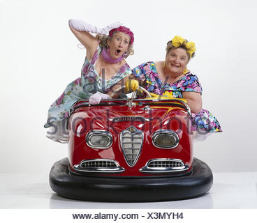 Women, two, middle old person, dodgem cars pleasure, amusement, melted, fun, Skooter, drive, studio, cut out - Stock Photo