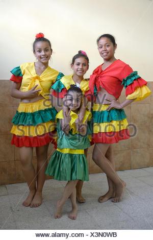 Children in traditional costume, Barrio San Martín, Bogotá, Colombia - Stock Photo
