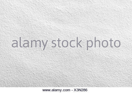 White wheat flour looks like snow for background. Top view - Stock Photo