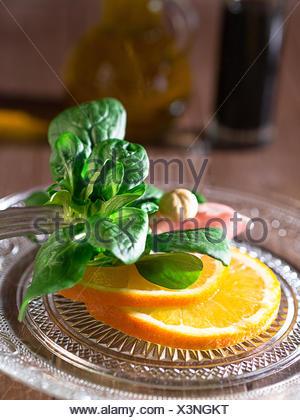 Lamb's lettuce with oranges and ham - Stock Photo