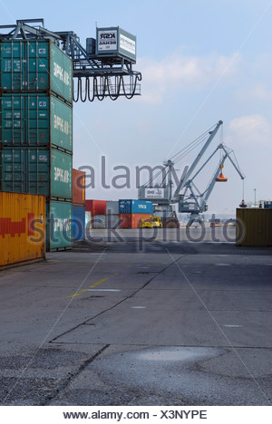Bonn Harbour, overlooking the terminal, cranes and gantry crane in the back, stacked oversea containers in the front, North Rhi - Stock Photo