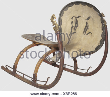 A German horse-drawn sleigh, mid 19th century Light wooden sleigh with iron fittings. The high curved runners are crowned with a carved horse's head in full relief. Leather harness painted in colour with the monogram 'JK'. Wooden seat. Height 109 cm. Length 132 cm, historic, historical, 19th century, hunt, hunts, hunting, utensil, piece of equipment, utensils, trophies, object, objects, stills, clipping, clippings, cut out, cut-out, cut-outs, Additional-Rights-Clearences-NA - Stock Photo