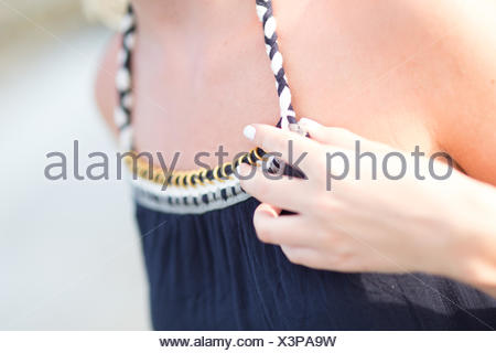Midsection Of Woman Adjusting Sundress - Stock Photo