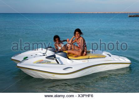 Egyptian girls on glass bottom boat with electric motor, Beach Mahmya, beach, Giftun Island, Hurghada, Egypt, Africa, Red Sea - Stock Photo