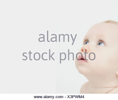 Close up of baby boys face - Stock Photo