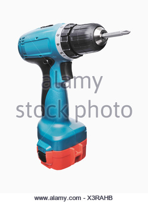Cordless screwdriver against white background, close up - Stock Photo