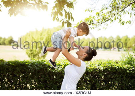 Mother playing with her little son - Stock Photo