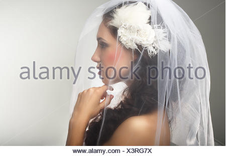 Engagement. Loveliness. Side view of Sincere Affectionate Woman in Veil - Stock Photo
