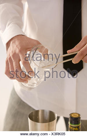 Barkeepers, detail, hands, glass, ice cube, fill, - Stock Photo