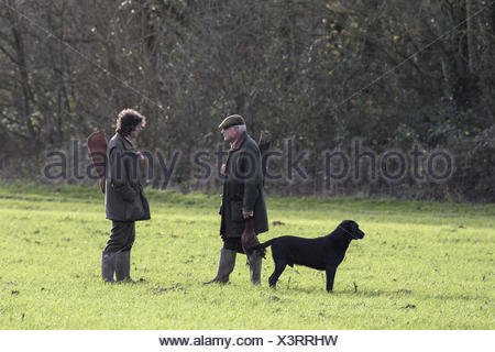 Two guns talking on shoot day at Bougle, Suffolk - Stock Photo