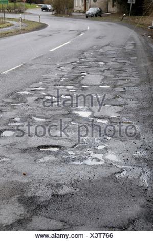 Road damage on the L286, North Rhine-Westphalia, Germany, Europe - Stock Photo