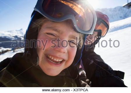 Children in ski helmets and goggles - Stock Photo