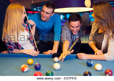 Friends hanging out at the bowling alley - Stock Photo