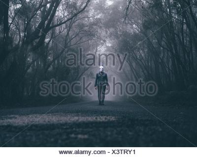 Man Wearing Rabbit Mask On Forest Road - Stock Photo