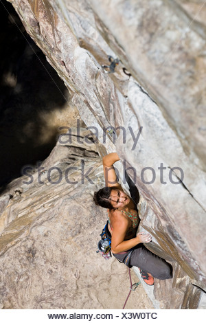 A young female lead climbing at Lake Louise, Rocky Mountains, Alberta, Canada. - Stock Photo
