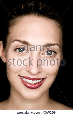 portrait of smiling young woman with shiny lipstick - Stock Photo