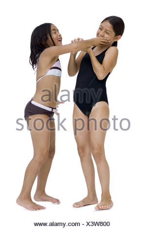 Two girls in bathing suits playfighting - Stock Photo