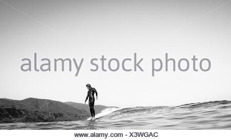Surfer sliding on a surfboard, Malibu, Los Angeles, California, USA