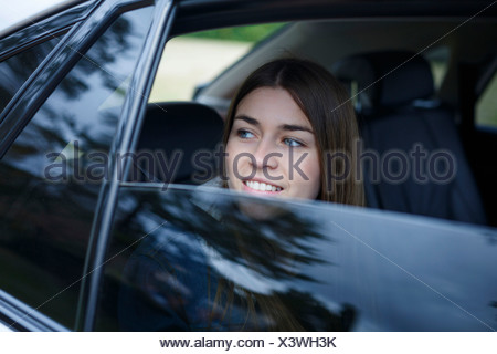 Young woman inside car - Stock Photo