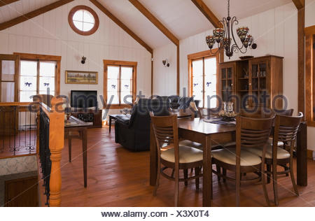 Dining/living room inside the extension a Canadiana cottage style fieldstone residential home built to look old in 2002 - Stock Photo