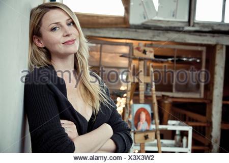 Mid adult woman in artist's studio, portrait - Stock Photo