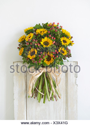 Bunch of flowers including sunflowers and berries, close-up - Stock Photo