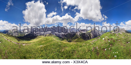 360 ° panoramic view from Mt Mahnkopf of the summits of the Karwendel Range, summit cross and dramatic cloud formation - Stock Photo