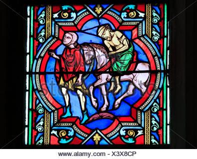 The Good Samaritan Parable,  Samaritan carries the injured traveller on his horse, by Oudinot of Paris, 1859, Feltwell, Norfolk, England, UK - Stock Photo