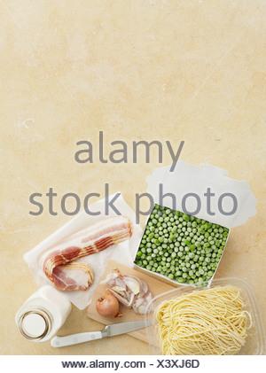 Fresh pasta, peas, bacon and onion - Stock Photo