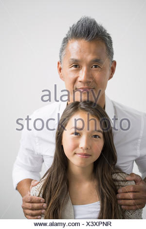 Portrait of smiling father and daughter - Stock Photo