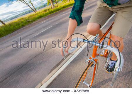 Sweden, Vastergotland, Lerum, Man cycling - Stock Photo