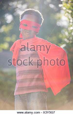 Boy is wearing a superhero costume - Stock Photo