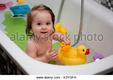 Young girl in bath - Stock Photo