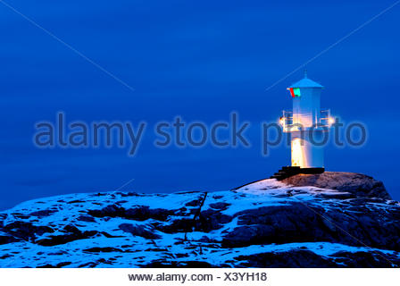 Bohuslan color image dusk evening horizontal lighthouse Marstrand navigate no people outdoors Scandinavia snow Sweden winter - Stock Photo