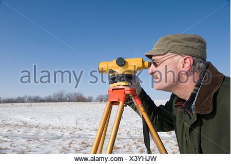 A man surveys a farm near Dunbar, Nebraska. - Stock Photo