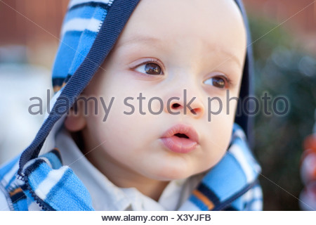 Close up of baby boy's face - Stock Photo
