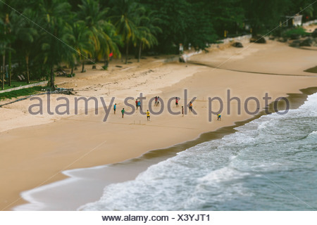 Thailand, Takua Pa, Khao Lak, people playing football on beach - Stock Photo