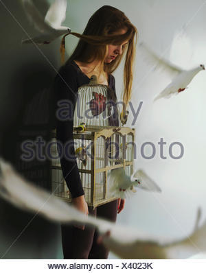 Woman with birdcage and doves - Stock Photo