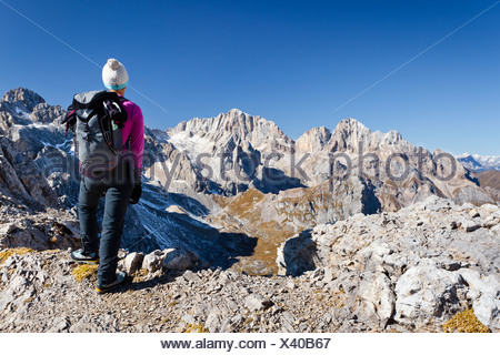 Hiker on Costabella Mountain while ascending the Bepi Zac Climbing Route in the San Pellegrino Valley above the San Pellegrino - Stock Photo