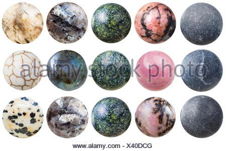 balls from shungite, rhodonite, labradorite, etc - Stock Photo